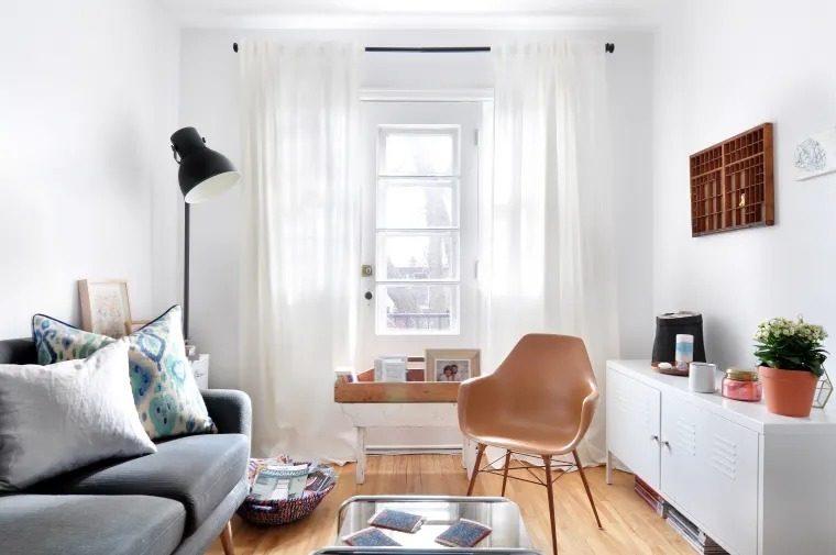 phòng khách nhỏ tone màu trắng